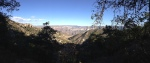 A panoramic shot of the distant rim of this huge canyon.