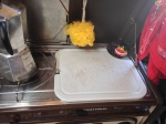 Coffee maker and cutting board.