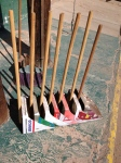 Dustpans recycled out of metal lard buckets.