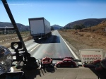 Being passed by a semi.  Narrow shoulder, narrow lanes.  Typical road.