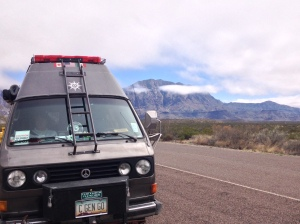 2 van at big bend with clouds