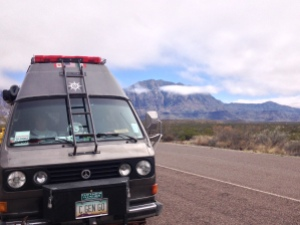 2 van at big bend with clouds