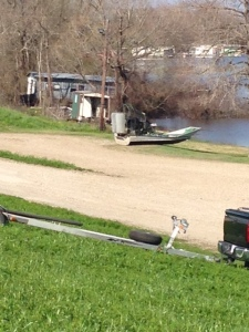 The airboat drives right up on the shore to park. It runs on a huge V6 engine.