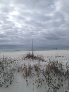 Powdery white sand and stormy skies in Florida panhandle.