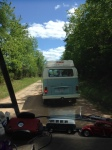 in a van following a bus