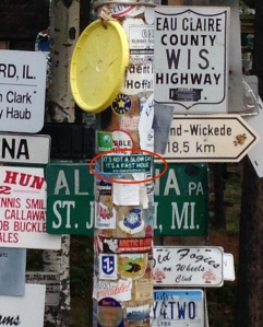 our sticker among sign posts