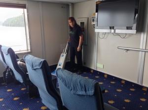 vacuuming the floor in movie lounge