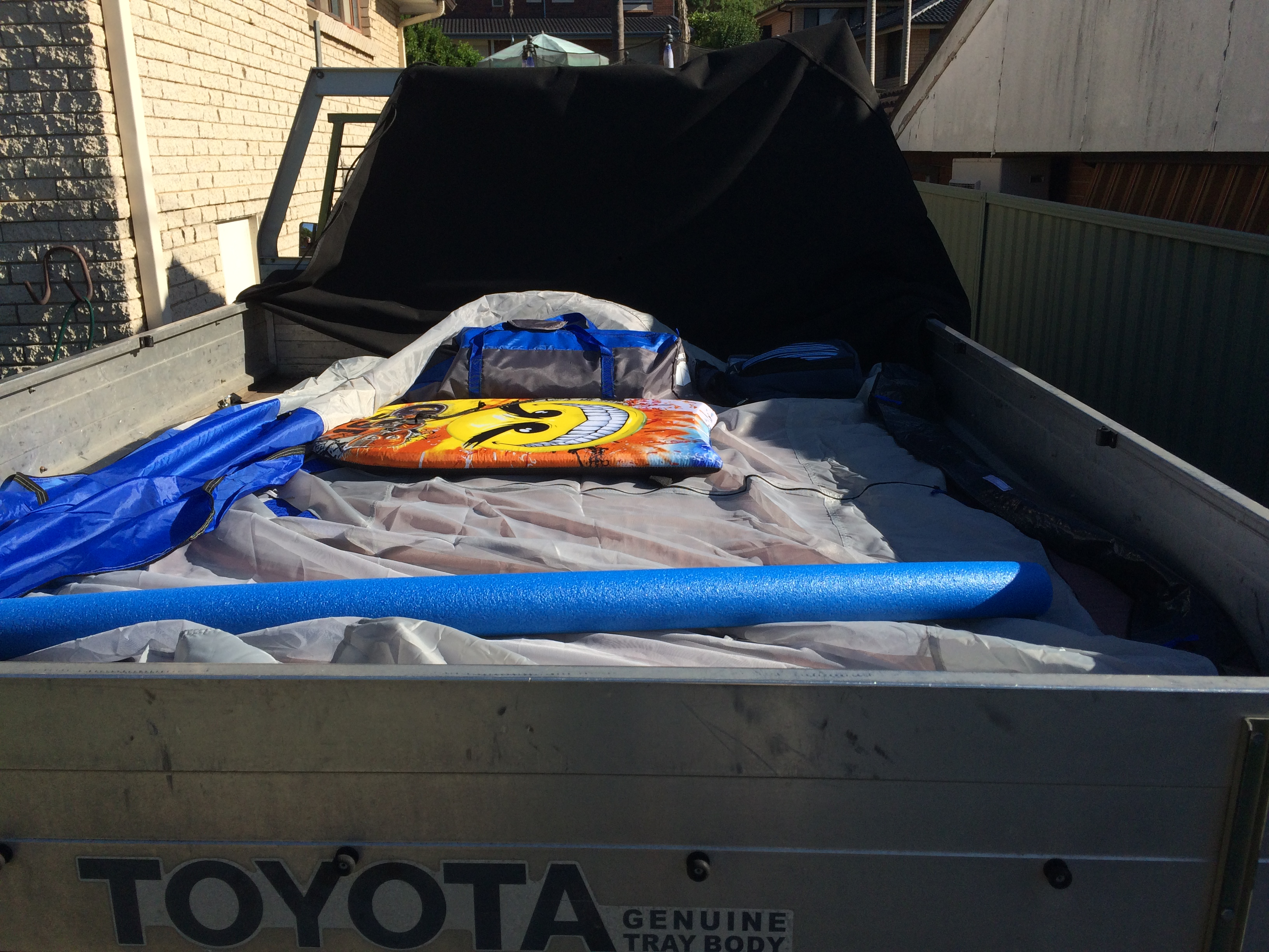 tent in back of ute with beach toys.JPG