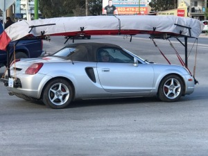 canoe on a sports car