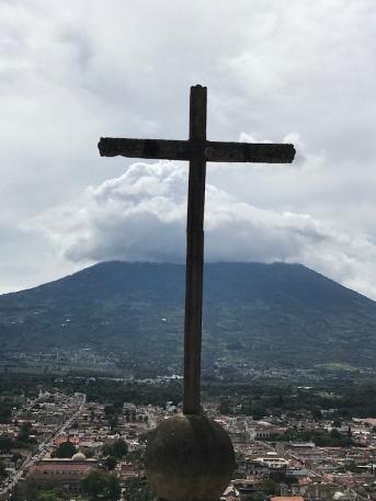 cross with volcano
