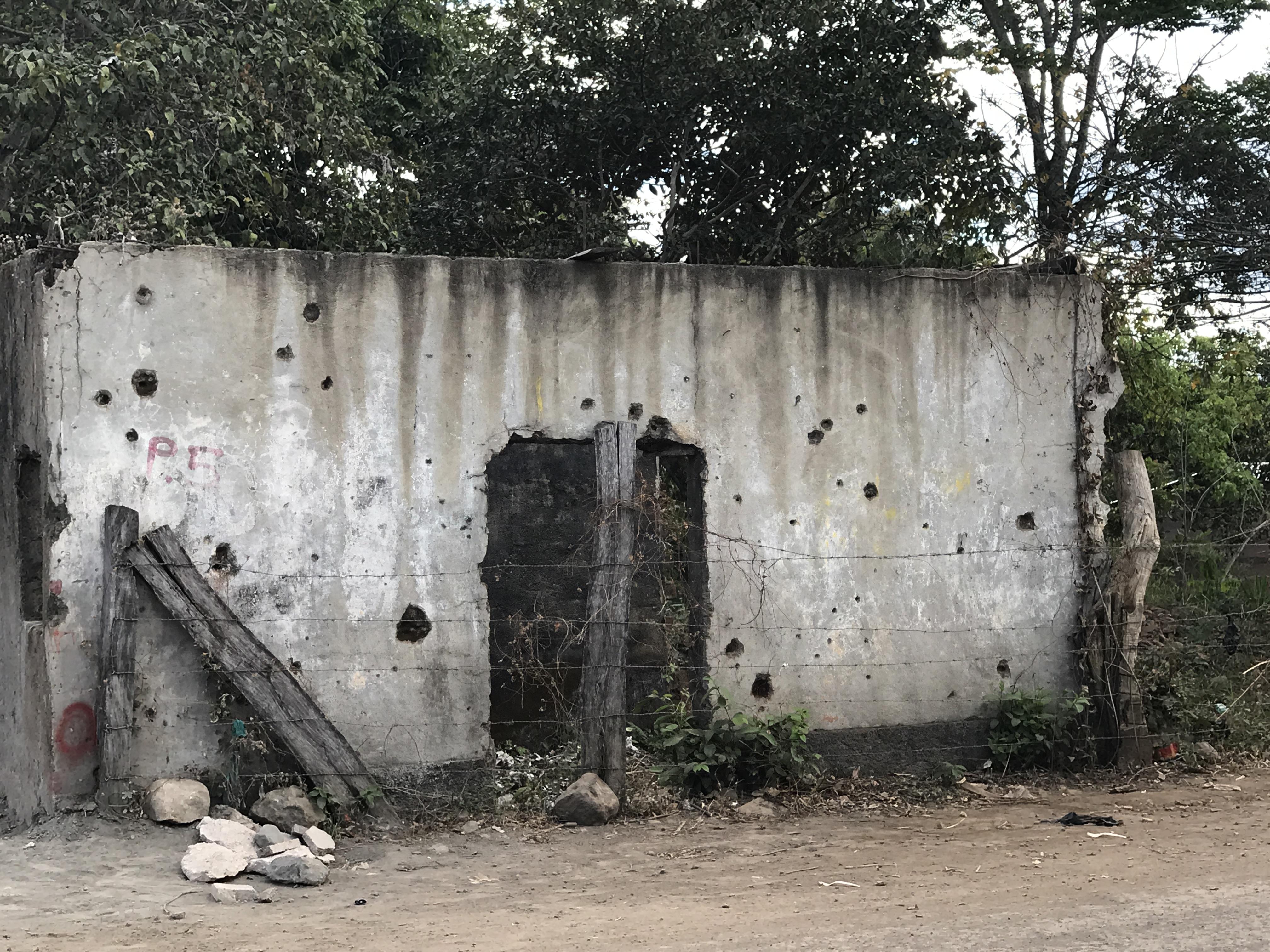 bullet holes in home.JPG
