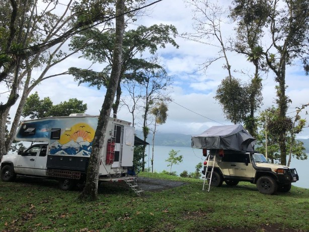 Arenal two rigs lake camp.jpg