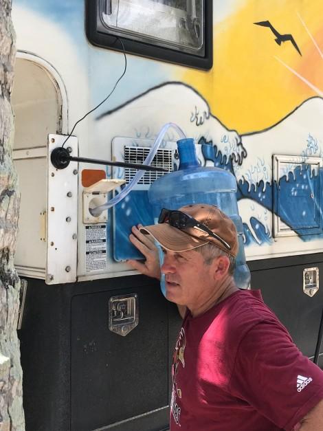 mike filling water.jpg