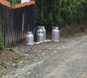 milk jugs at gate